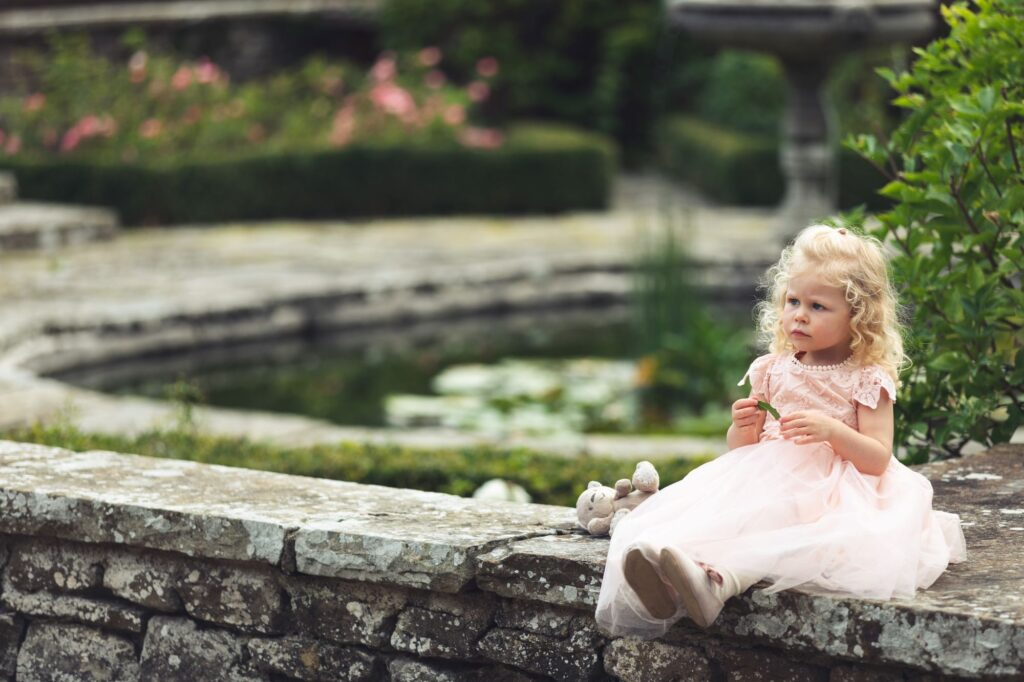 flower girls cuddly toy milton hill house hotel gardens steventon oxford wedding photography