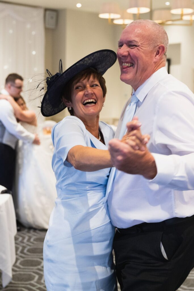 laughing guests dance milton hill house hotel steventon oxfordshire wedding photographers
