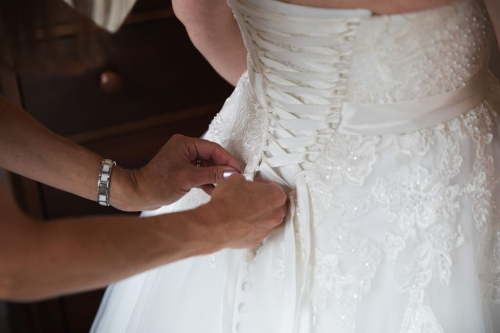 brides dress laces bridal prep streatley oxford wedding photographers