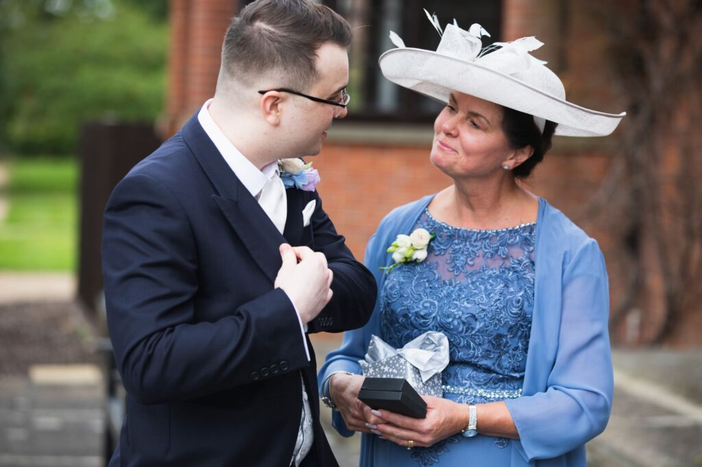 grooms mother presents gift milton hill house steventon oxford wedding photography