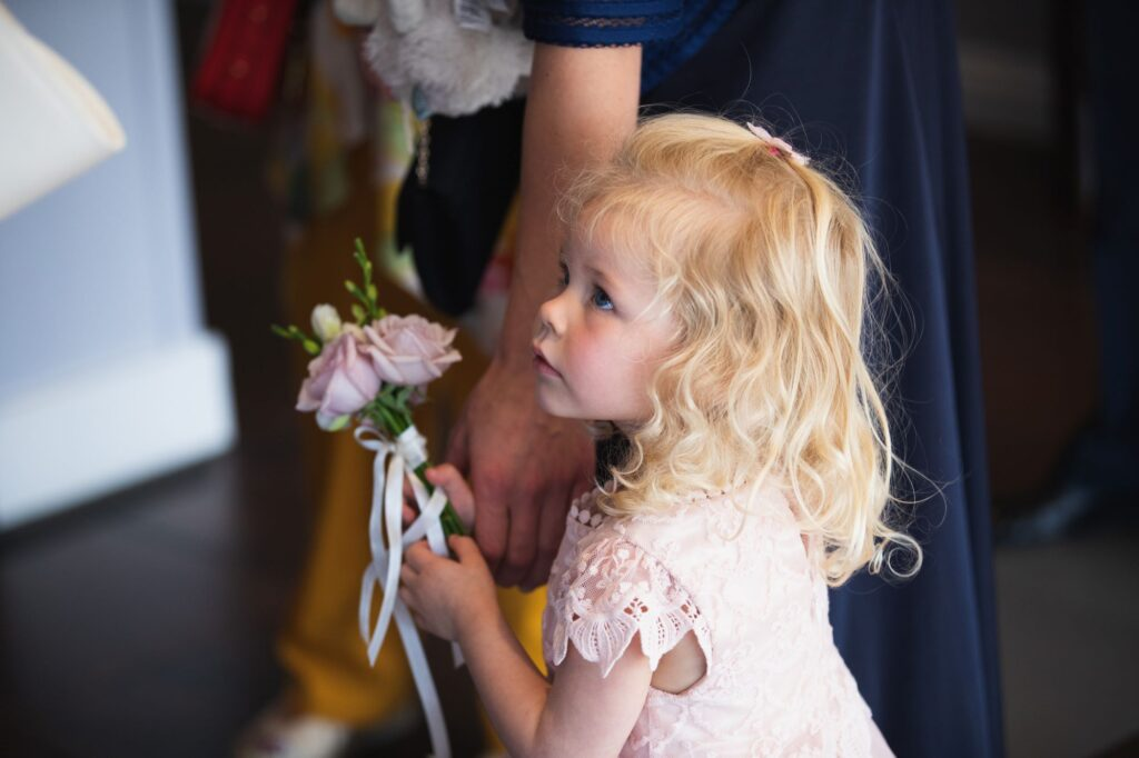 flower girl carries bouquet milton hill house steventon oxfordshire wedding photographer