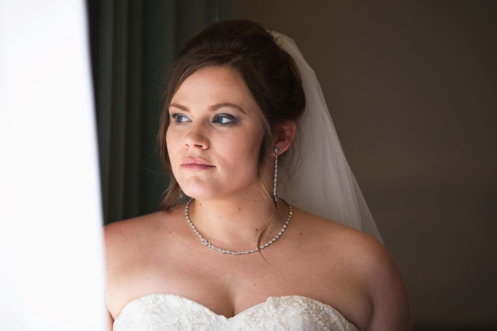 a bride awaits ceremony miltlon hill house steventon oxford wedding photographer