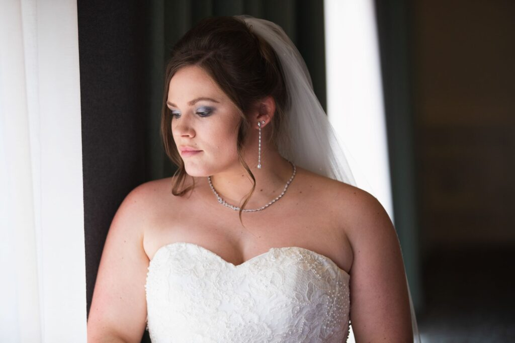 bride awaiting marriage ceremony milton hill house steventon oxford wedding photographers