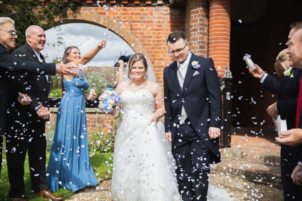 bride groom confetti parade milton hill house steventon oxfordshire wedding photographers