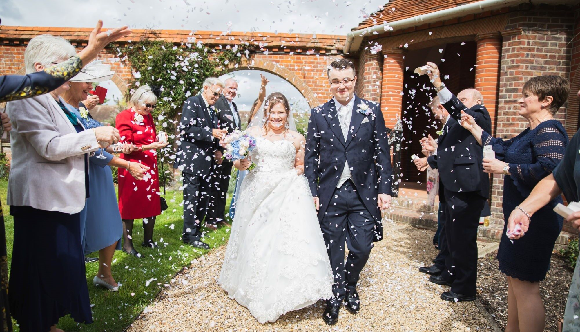 smiling couples confetti shower milton hill house steventon oxfordshire wedding photographer