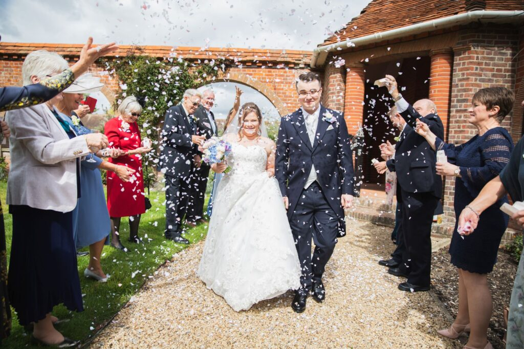 smiling couples confetti shower milton hill house steventon oxfordshire wedding photography