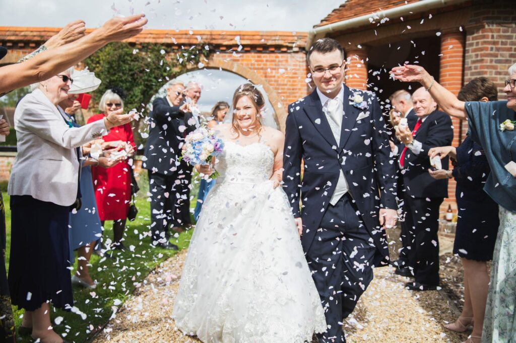 happy bride grooms confetti walk milton hill house steventon oxford wedding photographer