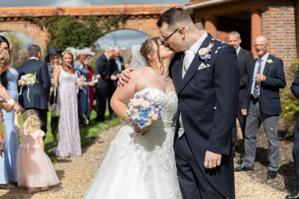 bride groom first kiss milton hill house steventon oxford wedding photographers