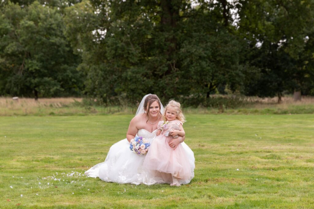 flower girl bride portrait milton hill house grounds steventon oxfordshire wedding photographer