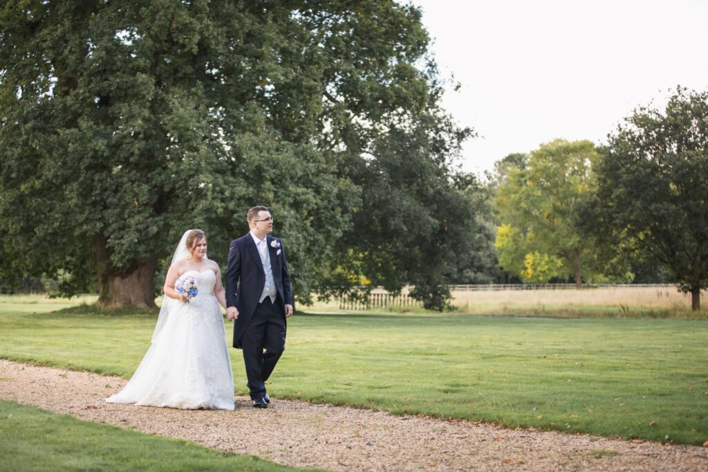 just married couple walk milton hill house grounds steventon oxfordshire wedding photographer
