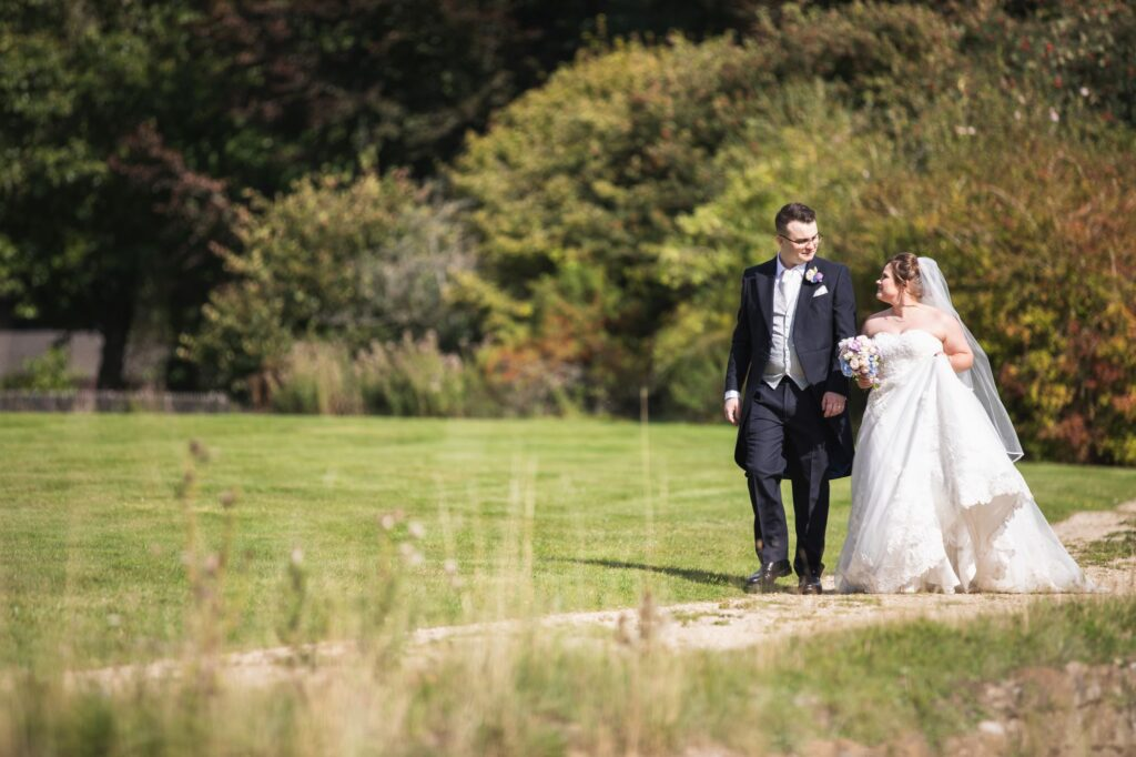 bride groom walk alone milton hill house grounds steventon oxford wedding photographers