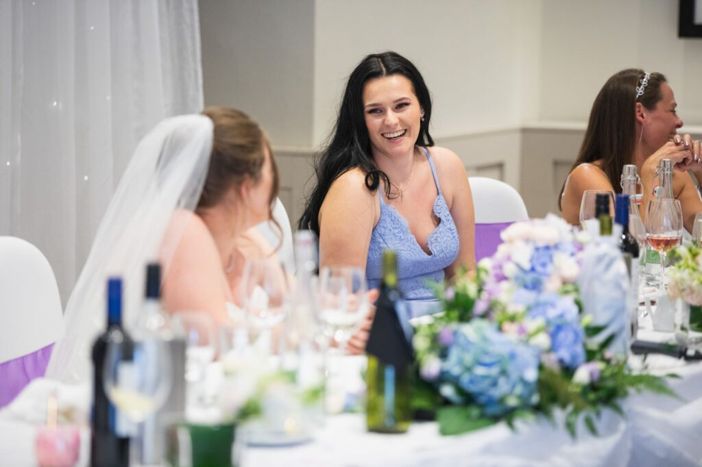 laughing bridesmaid milton hill house dinner reception steventon oxford wedding photographer