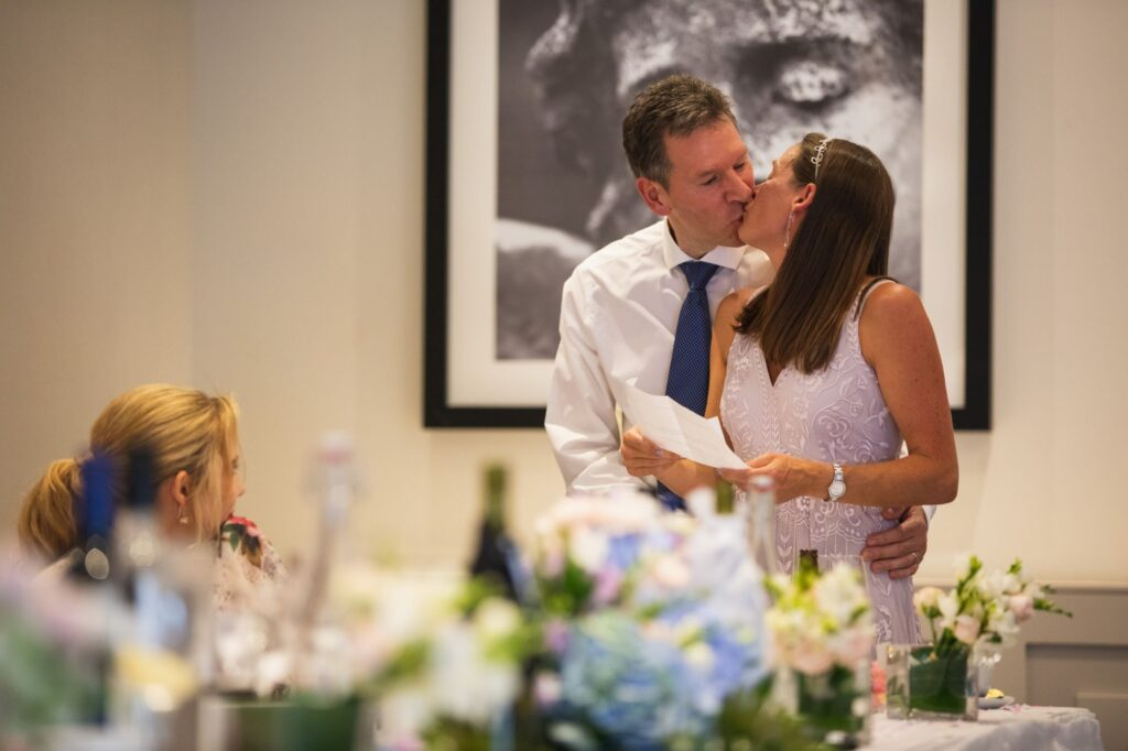 top table guests kiss milton hill house dinner reception steventon oxford wedding photographer