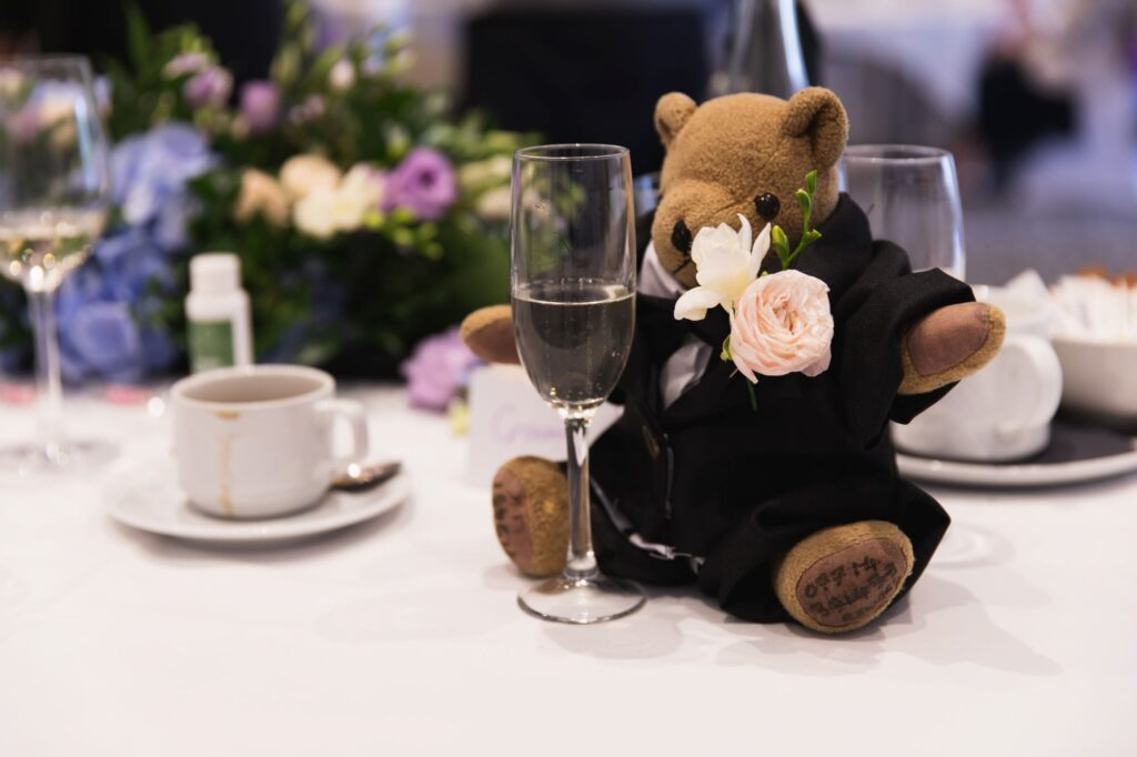 teddy bear eyes red wine glass milton hill house dinner reception steventon oxfordshire wedding photographer