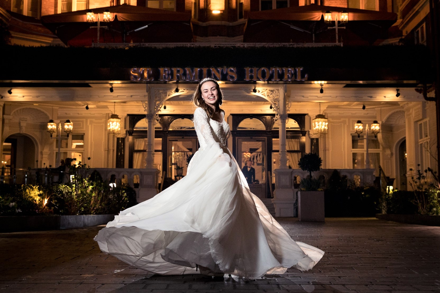 06 bride flowing white dress twirls outside luxury 5star st.ermins hotel london venue oxfordshire wedding photography 1024x682 1024x682