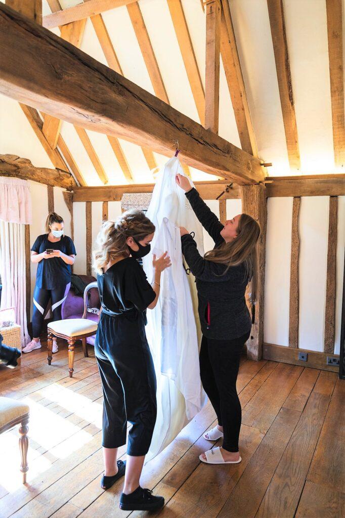 hanging brides dress cain manor venue hampshire surrey borders oxford wedding photography