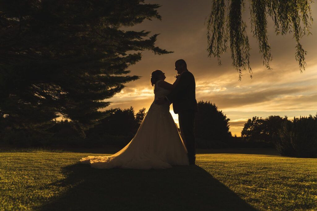 bride grooms romantic sunset moment cain manor grounds surrey oxford wedding photographers