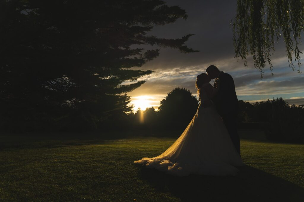 grooms romantic sunset kiss cain manor grounds surrey oxford wedding photography