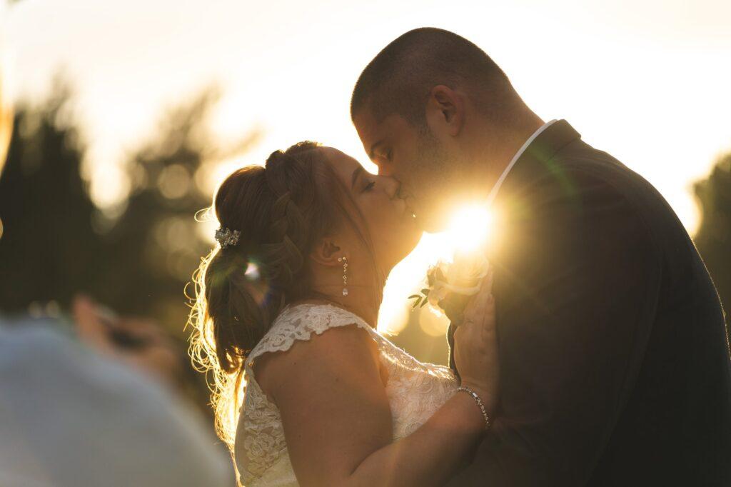bride groom enjoy romantic sunset kiss cain manor gardens hampshire surrey border oxford wedding photographers