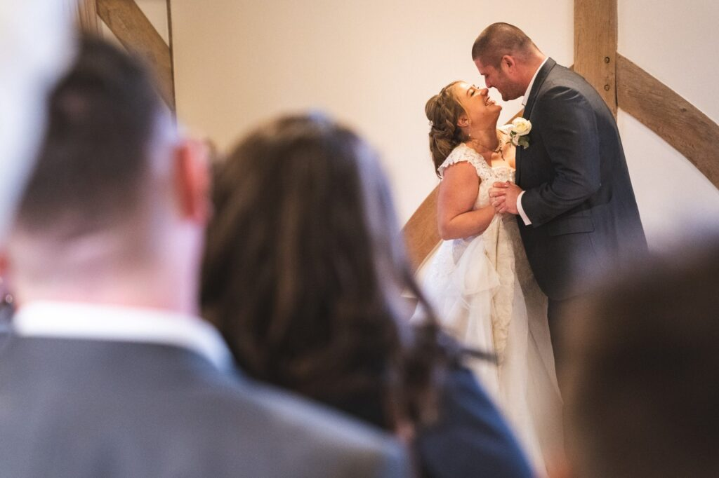 guests watch bride grooms first dance cain manor surrey oxfordshire wedding photographer