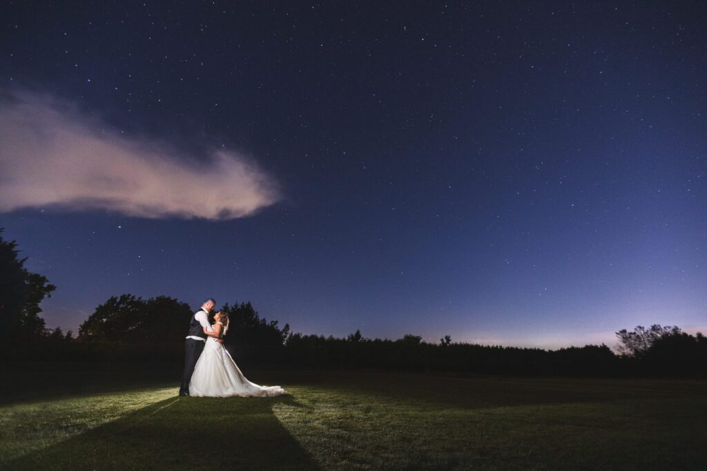 bride grooms starry night embrace cain manor grounds surrey oxfordshire wedding photographers