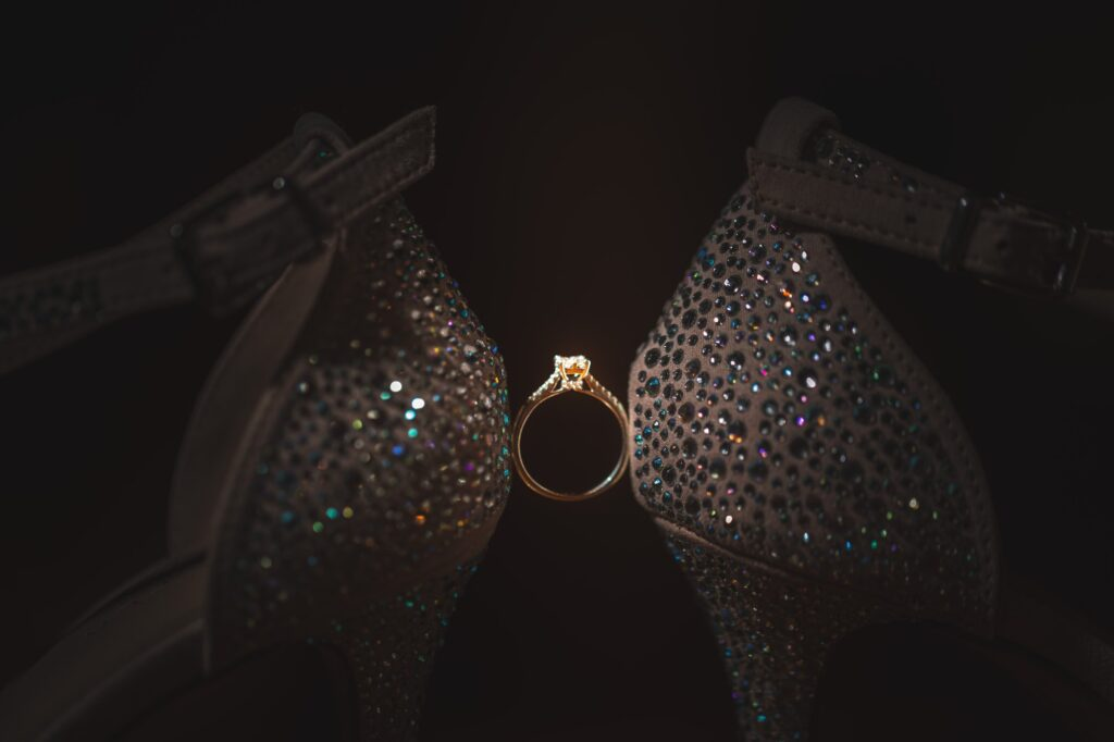 brides shoes supporting ring cain manor venue hampshire surrey borders oxfordshire wedding photography