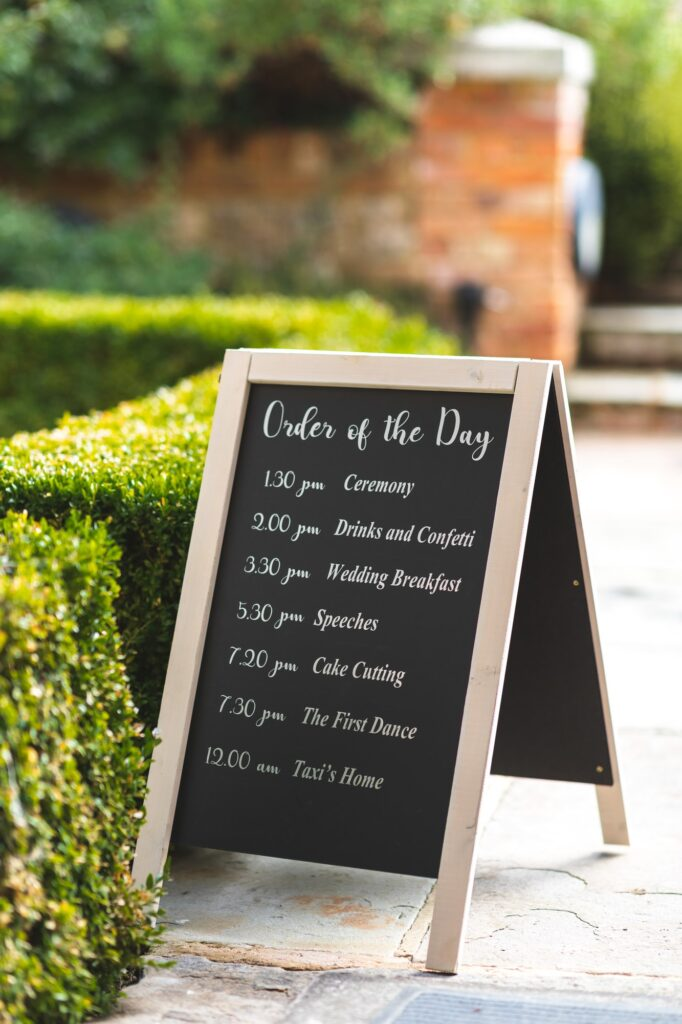 order of the day blackboard sign cain manor venue hampshire surrey borders oxfordshire wedding photographers