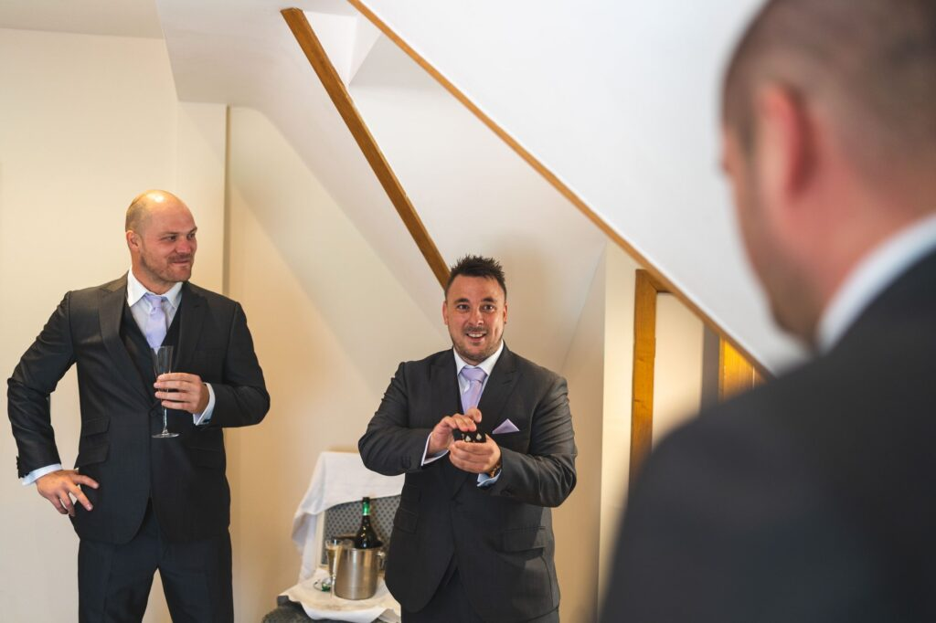 groomsmen relax groom prep cain manor surrey oxfordshire wedding photographer