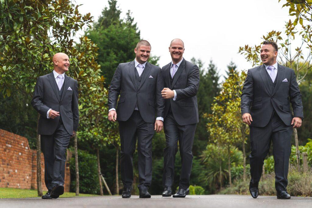 groom groomsmen depart for cain manor ceremony surrey oxfordshire wedding photographers