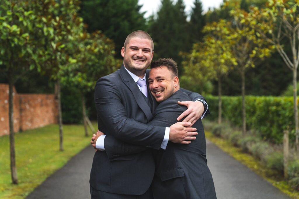 groom bestman hug cain manor surrey oxfordshire wedding photography