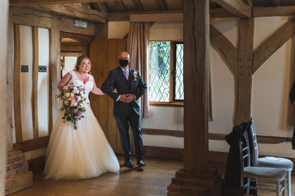 bride father of the bride enter ceremony room cain manor surrey oxfordshire wedding photographer