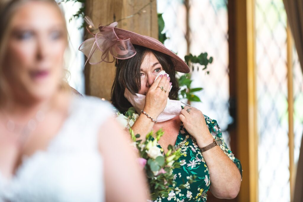 tearful mother of the bride cain manor marriage ceremony surrey oxford wedding photographer