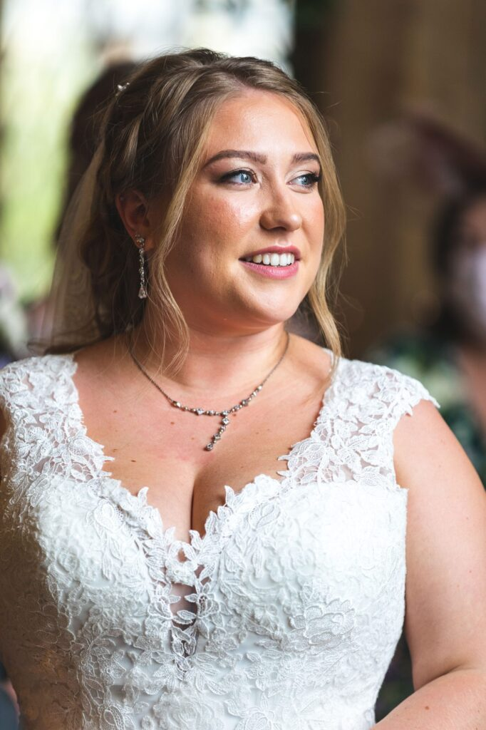 bride hears celebrant cain manor ceremony surrey oxford wedding photography