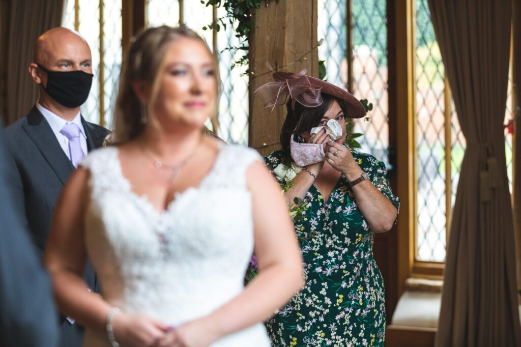 mother of bride wipes tears cain manor ceremony surrey oxfordshire wedding photographer