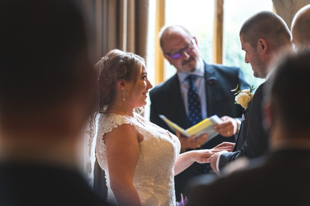 bride groom exchange rings cain manor ceremony surrey oxfordshire wedding photography