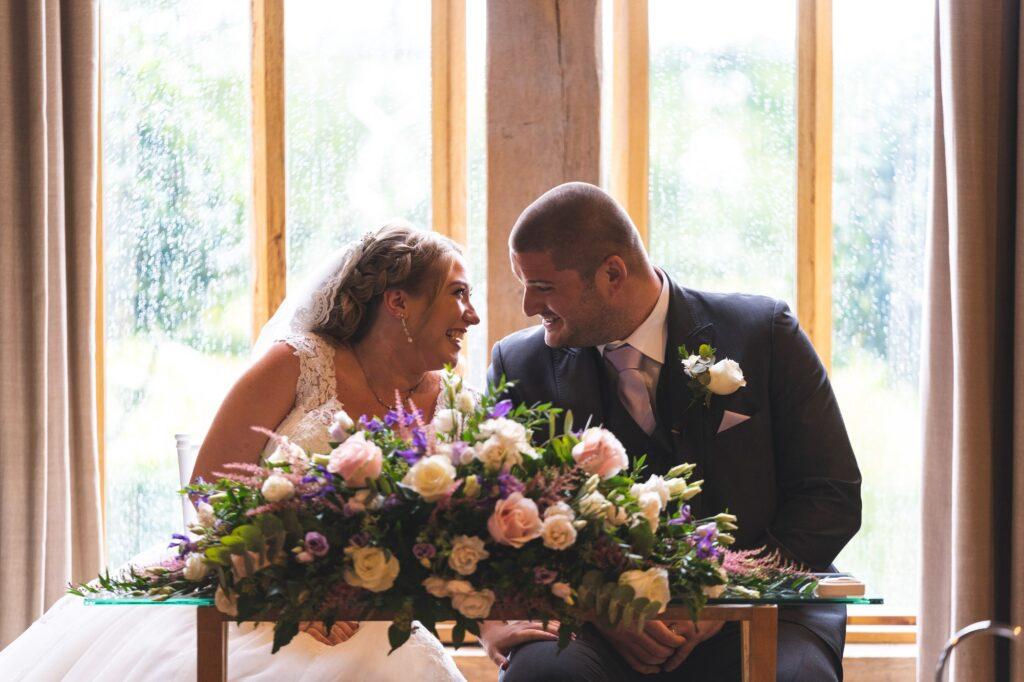 smiling bride groom sign register cain manor surrey oxford wedding photography