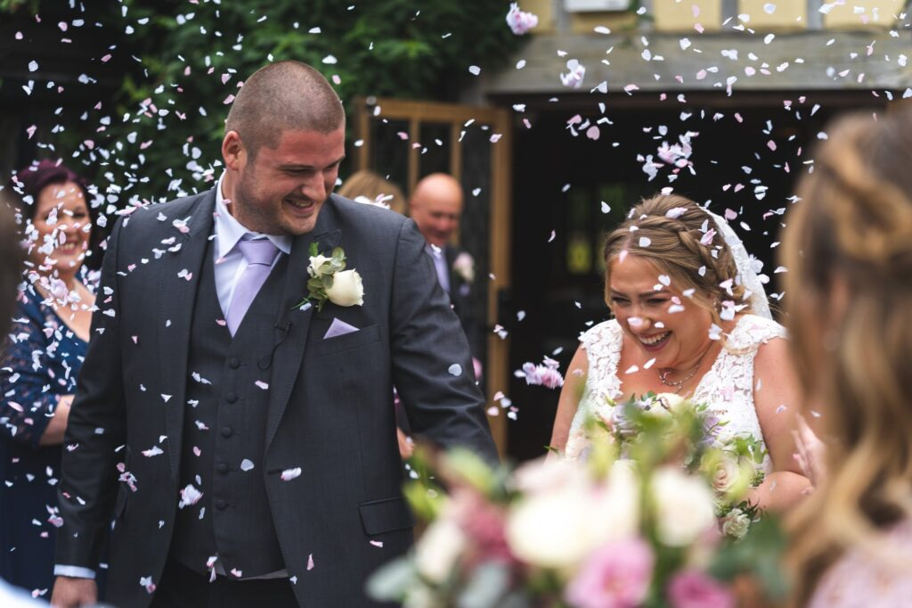 smiling groom brides confetti shower cain manor surrey oxford wedding photography