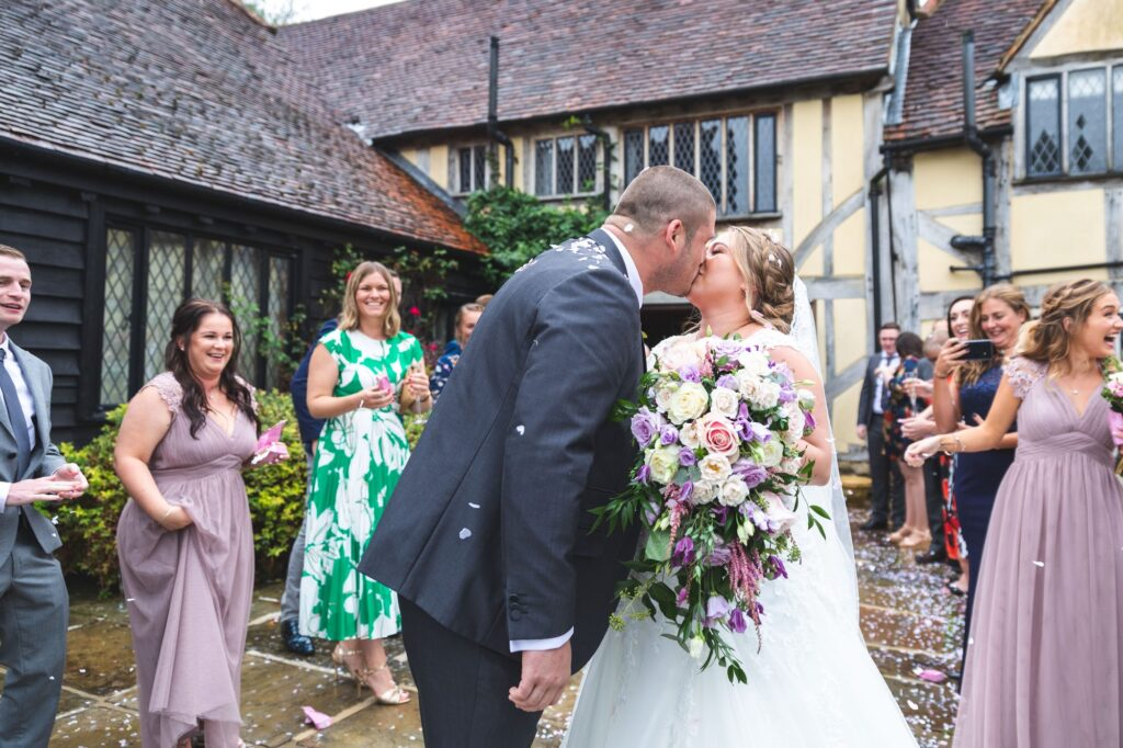 confetti covered bride groom kiss cain manor surrey oxfordshire wedding photography
