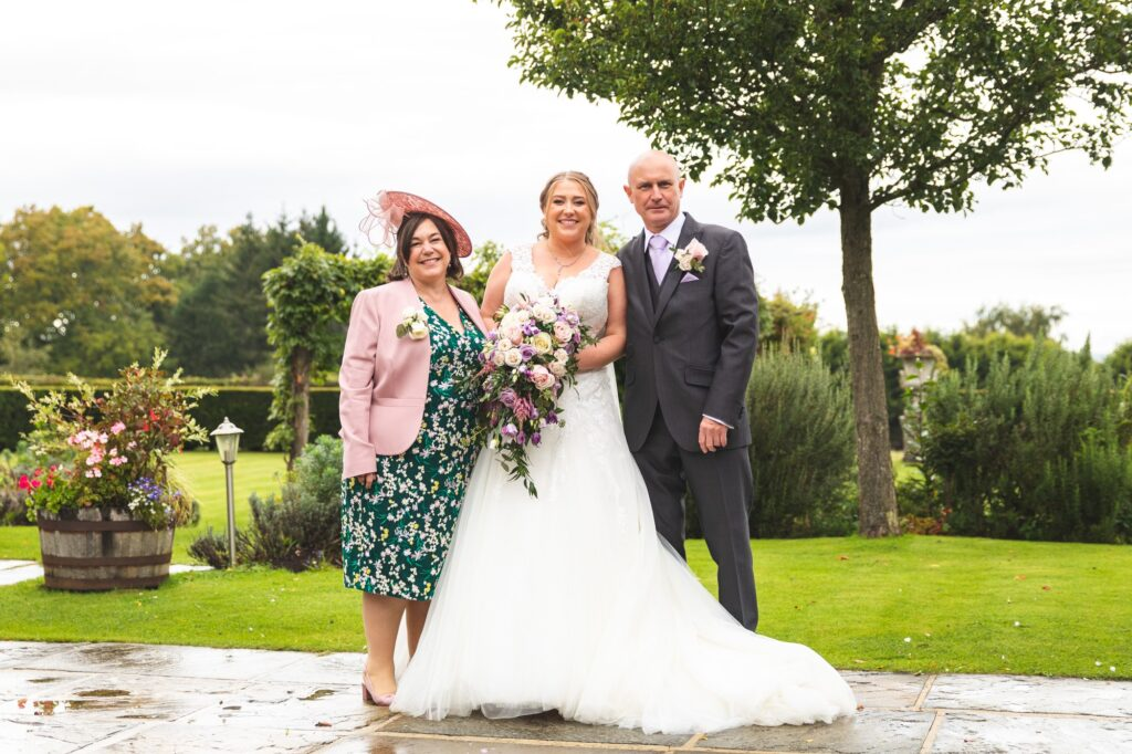 bride mother of the bride father of the bride formal portrait cain manor gardens surrey oxfordshire wedding photographer