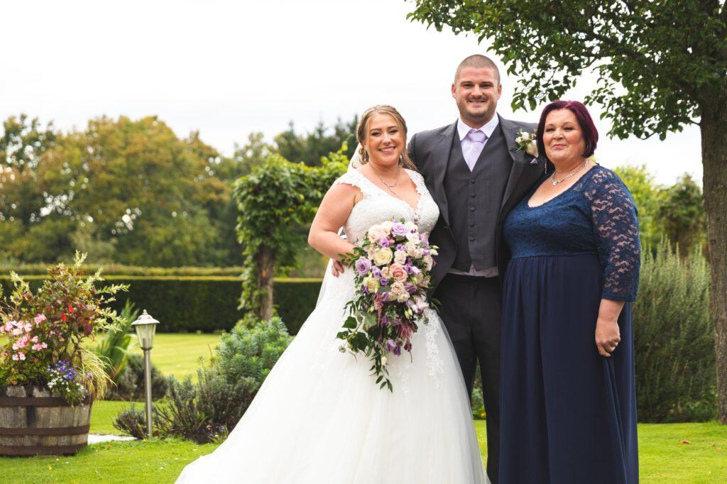 bride groom mother of groom formal portrait cain manor gardens surrey oxfordshire wedding photographers