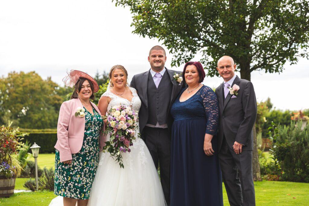bride groom parents formal portrait cain manor gardens surrey oxfordshire wedding photography