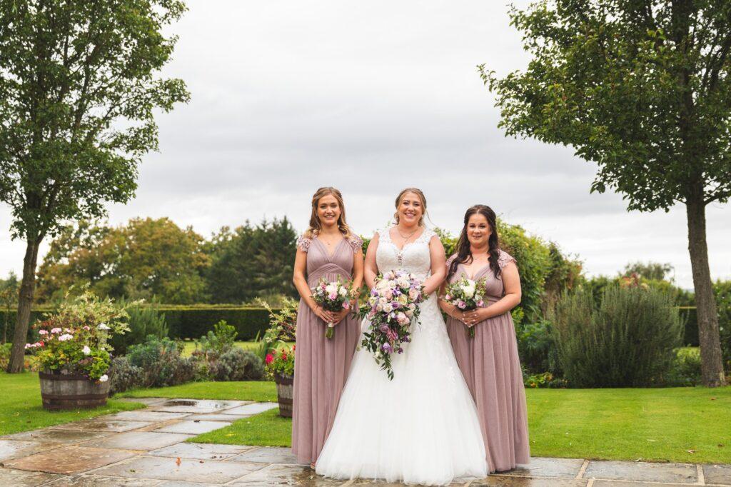 bride bridesmaids formal portrait cain manor gardens hampshire surrey borders oxford wedding photographer
