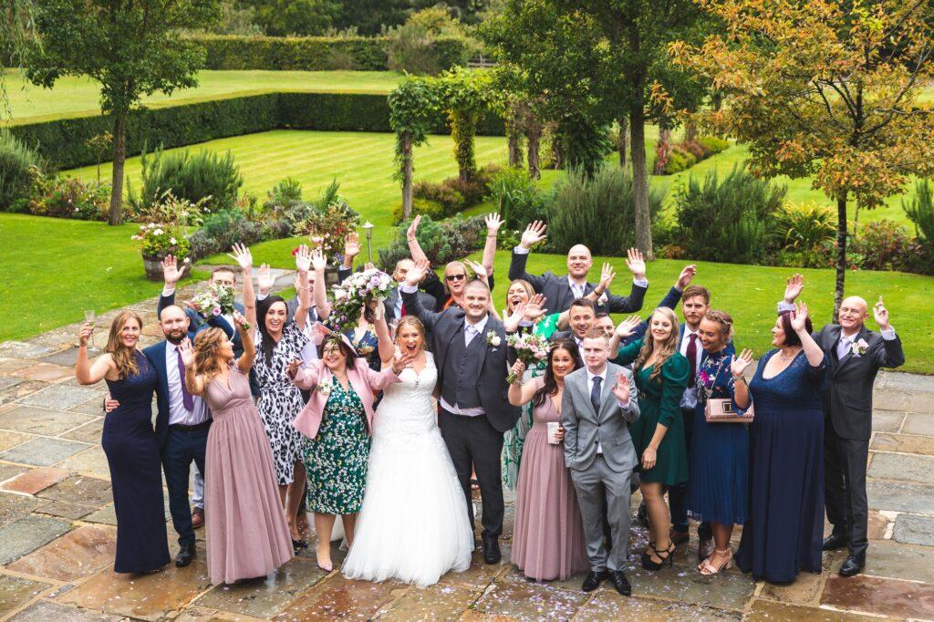waving bridal party covid wedding cain manor gardens surrey oxford wedding photographers