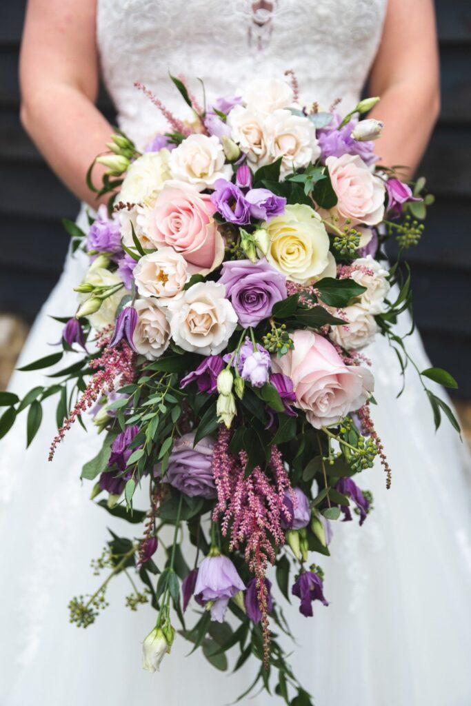 bride holding bouquet cain manor hampshire surrey borders oxford wedding photography