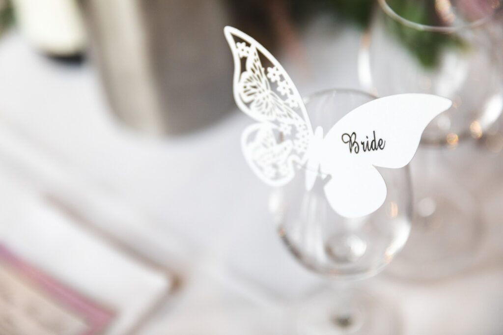 brides butterfly table decoration cain manor reception surrey oxford wedding photographers