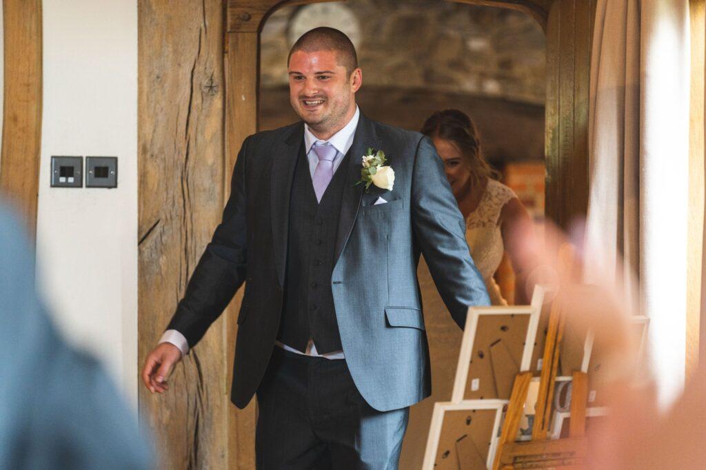 groom bride enter reception room cain manor surrey oxfordshire wedding photographer