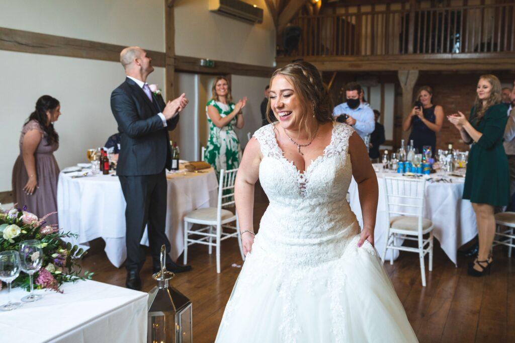 reception guests applaud brides entrance cain manor surrey oxfordshire wedding photographers