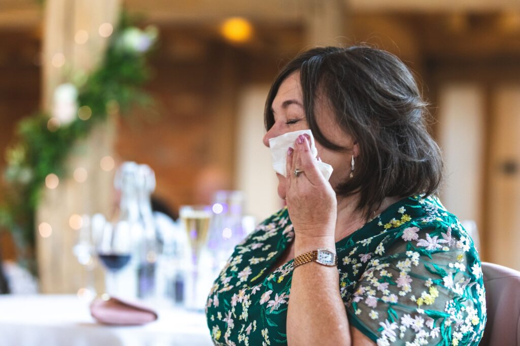 tearful mother of bride hears reception speech cain manor surrey oxfordshire wedding photographer