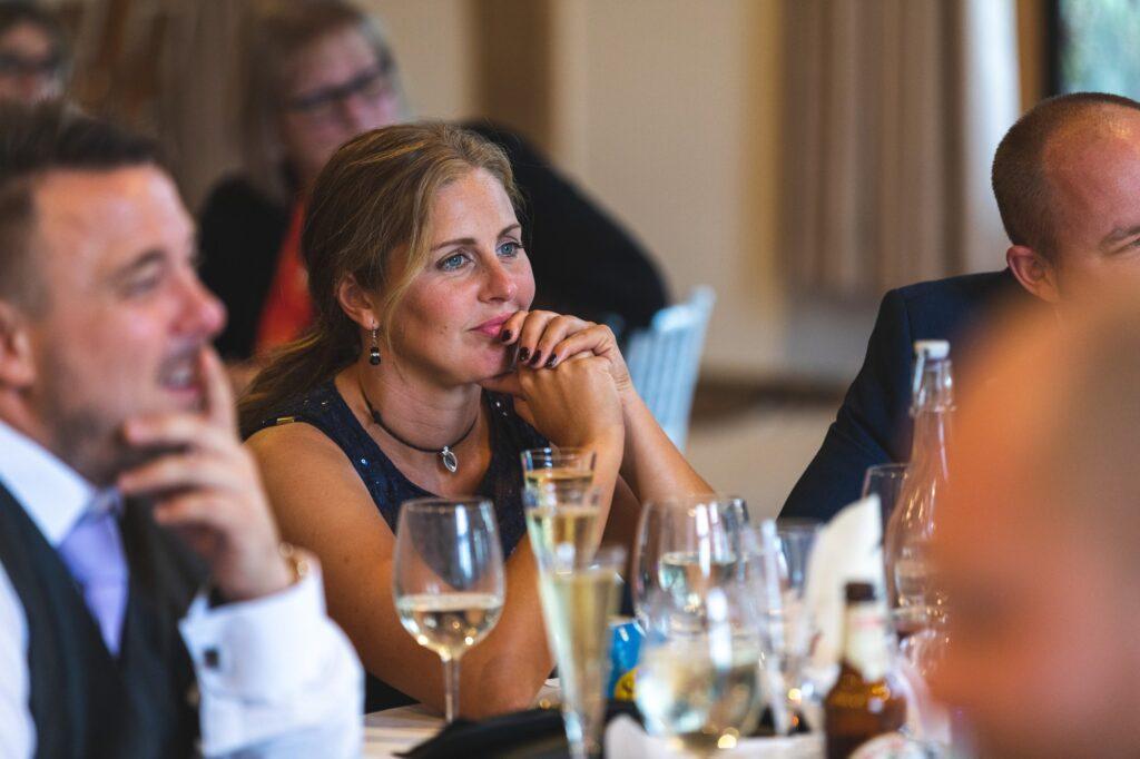 guest hears reception speech cain manor surrey oxfordshire wedding photography