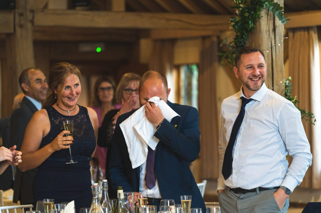 emotional guest wipes tears cain manor reception surrey oxford wedding photographers